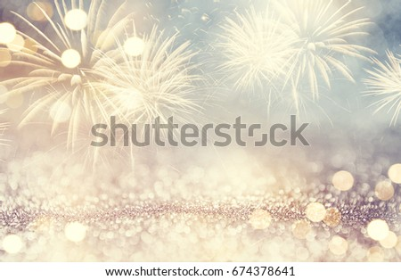 Vintage Gold and blue Fireworks and bokeh in New Year eve and space for text. Abstract background holiday. #674378641