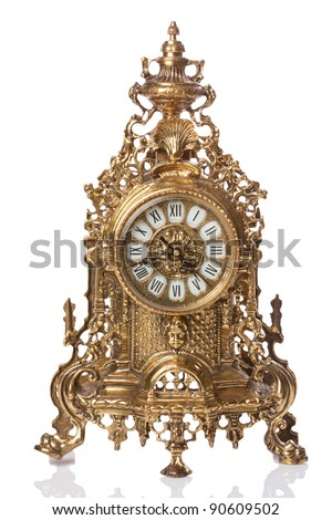 vintage gold clock with reflex on white - stock photo
