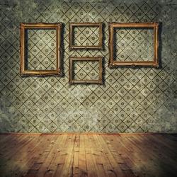 Vintage golden frames on grunge wall
