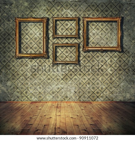 Vintage golden frames on grunge wall - stock photo