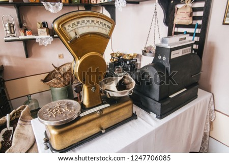 Vintage golden weighing scales as a part of restautant interior