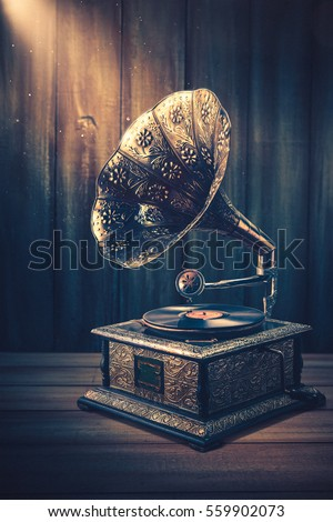 vintage gramophone on a wooden background with dramatic lighting #559902073