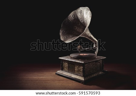 vintage gramophone on a wooden background with dramatic lighting #591570593