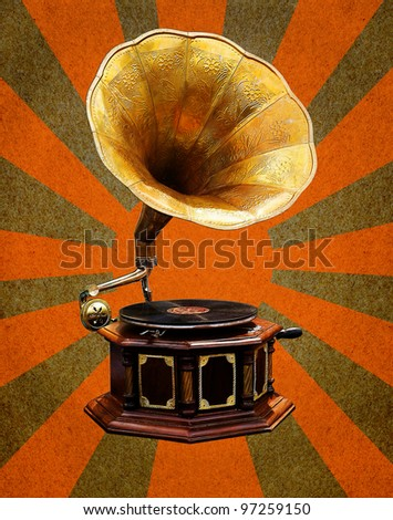 Vintage Gramophone  on grunge paper with abstract sun rays