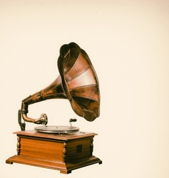 Vintage gramophone player with vinyl record.
