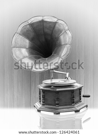 Vintage Gramophone with disc isolated on grunge background bell mouth