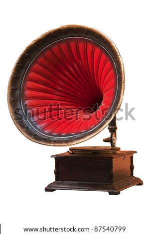 Vintage gramophone with horn speaker for playing music over plates isolated on white