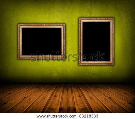 vintage green interior with empty frame hanging on the wall