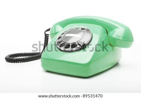 vintage green telephone isolated over white background