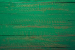 Vintage green wood background texture with knots and nail holes. Old painted wood wall. Brown abstract background. Vintage green wooden dark horizontal boards. Front view with copy space. Background f
