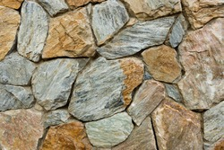 Vintage grey and brown color stone rock grunge textured background exterior wall material for decorated architecture building look like natural design such as outdoor cafe, home garden and condominium