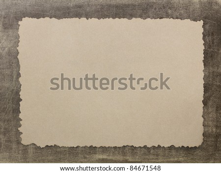 Vintage grunge burnt paper on brown background