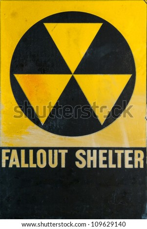 Vintage grunge Cold War era civil defense fallout shelter refuge sign for emergency and nuclear attack protection