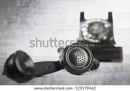 vintage grunge phone on white - stock photo