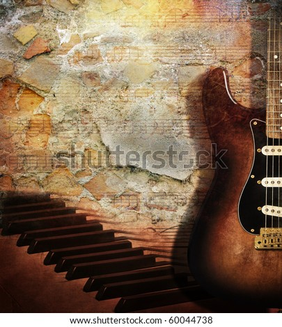Vintage grunge style background With guitar and piano on brick wall