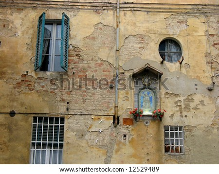 vintage grungy street wall on the Siena town Italy