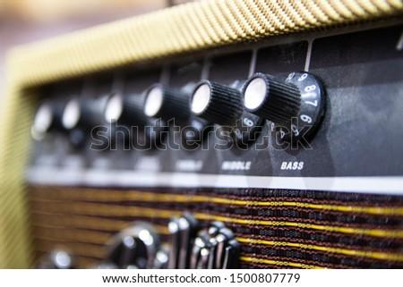 vintage guitar amp knobs close up.
