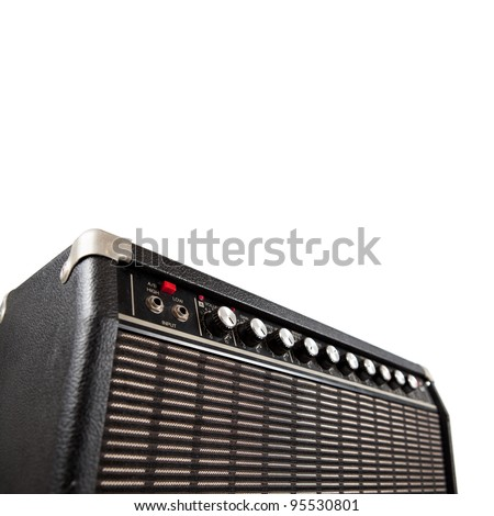Vintage guitar amplifier, shot from low angle, isolated on white.