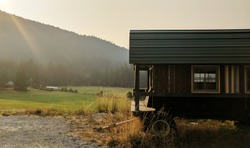 Vintage gypsy wagon in mountainous landscape