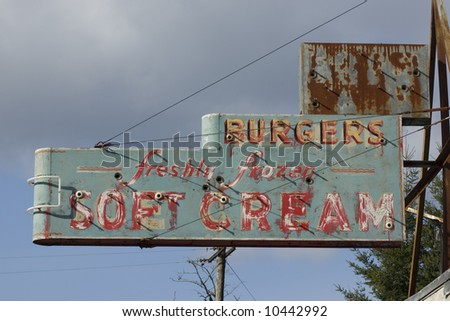 Vintage hamburger and frozen ice cream restaurant sign.