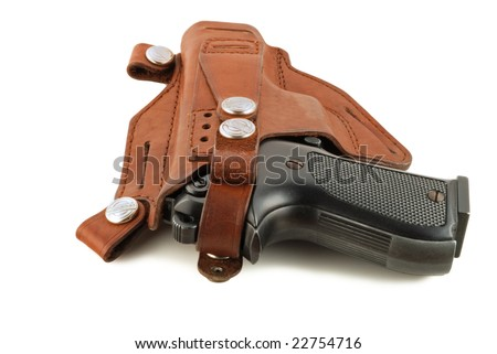 vintage handgun in a leather holster isolated on white