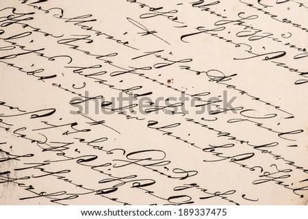 vintage handwriting with undefined text. handwritten text. manuscript. grunge paper background