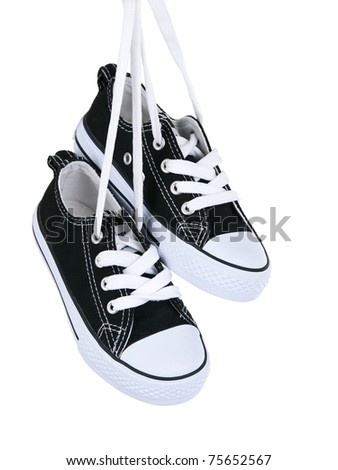 Vintage hanging black shoes on pure white background