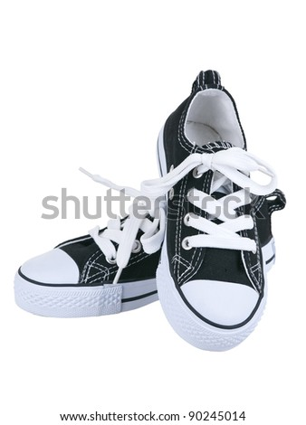 Vintage hanging black shoes on pure white background - stock photo
