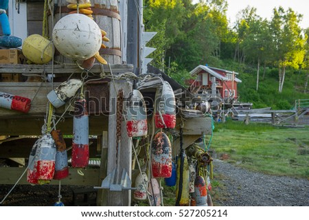 vintage hanging buoys with a...
