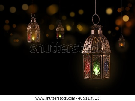 Vintage hanging lantern.\Ramadan mood at night with light decoration in the background.