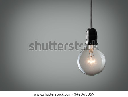 Vintage hanging light bulb over gray background  #342363059