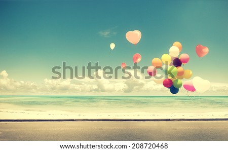 Vintage heart balloon on beach blue sky concept of love in summer and wedding honeymoon