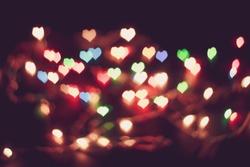 Vintage heart broken Light Background. Love Background. Bokeh Light. Valentine's Day. Valentine Background. Blurred photo. Blurred Background. Noise pollution. Grain photo.