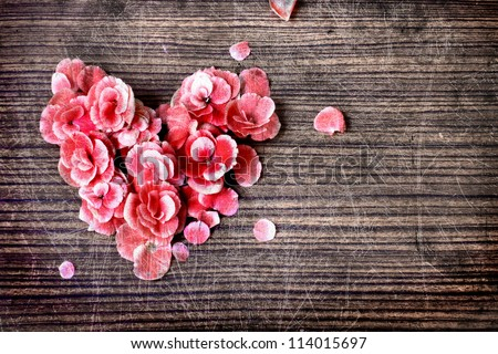 vintage heart from flowers   on wooden table/valentin day background