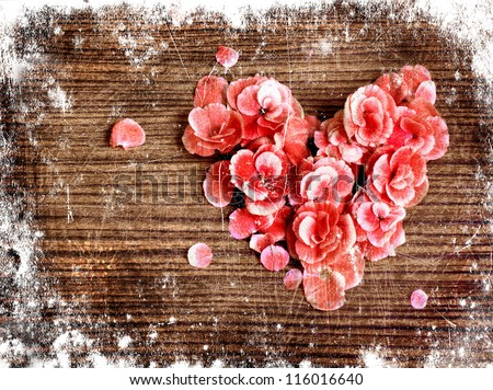 vintage heart from flowers on wooden table/valentin day or christmas background/valentin es  day card - stock photo