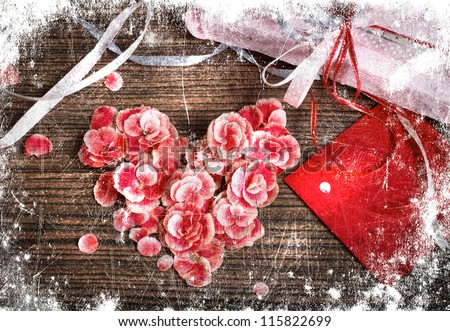 vintage heart from flowers on wooden table/valentin day or christmas background/valentines card with heart