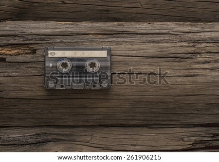 vintage hi-end transparent plastic material audio cassette on cracked old retro vintage aged wooden table texture with empty space for inscription paper sticker label  Side b