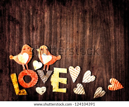 """Vintage holidays card with a two birds and hearts  as a symbol of love/valentines day card with word """"love"""""""