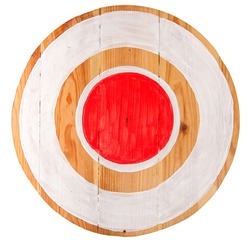 Vintage homemade wooden round target with red center on white background