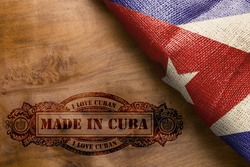 Vintage hot imprint on a wooden surface Made in Cuba.