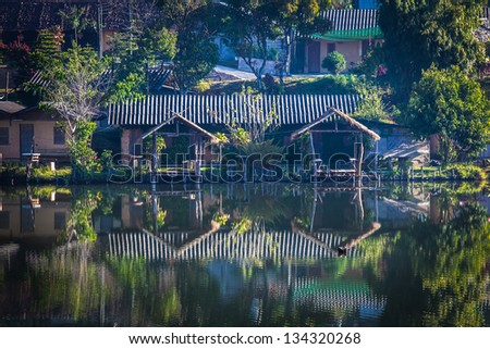 Vintage house on lakeside with reflections