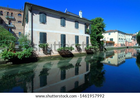 vintage houses on the canal in Treviso in Italy Stock fotó ©