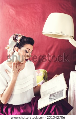 vintage housewife reads magazine in in Beauty salon
