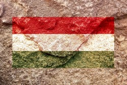 Vintage Hungary national flag icon pattern isolated on weathered solid rock wall background, abstract positive design faithful Hungarian politics society conflicts issues concept texture wallpaper