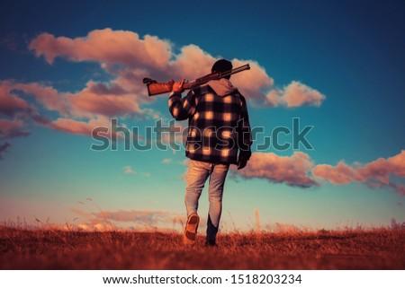 Vintage hunter. Hunter with shotgun gun on hunt. Poacher in the Forest