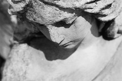 Vintage image of a sad angel on a cemetery (details)