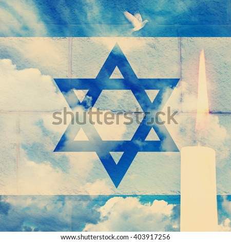 Vintage image of Israeli national flag wall defense and sky background with burning candle