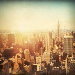 Vintage image of New York City Manhattan skyline at sunset.