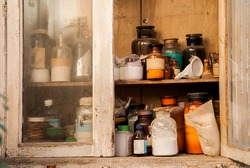 Vintage image of still life composition,glass chemical bottle in wooden cupboard
