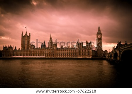 Vintage image of the Big Ben and the Houses of Parliament in sepia tones with a dramatic cloudy sky